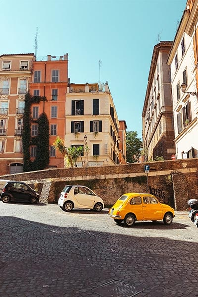 Street in Rome with accommodation and cars