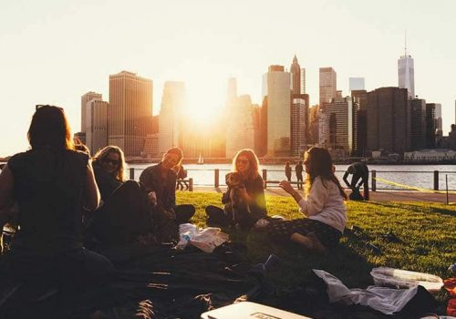 friends sitting in a park having a picnic
